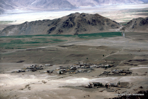 A village near Ganden overlooked by treeless slopes