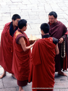 4 monks in courtyard