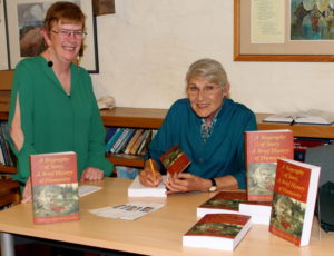 Book signing. Watched by Brenda Cubbon of U3A.